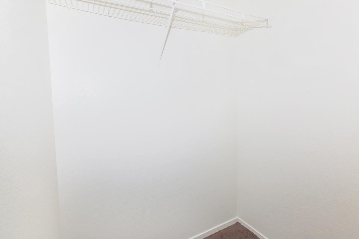 Closet space at Las Brisas De Cheyenne Apartments