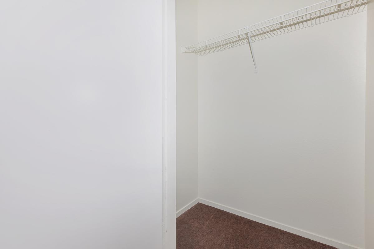 Your closet at Las Brisas De Cheyenne Apartments