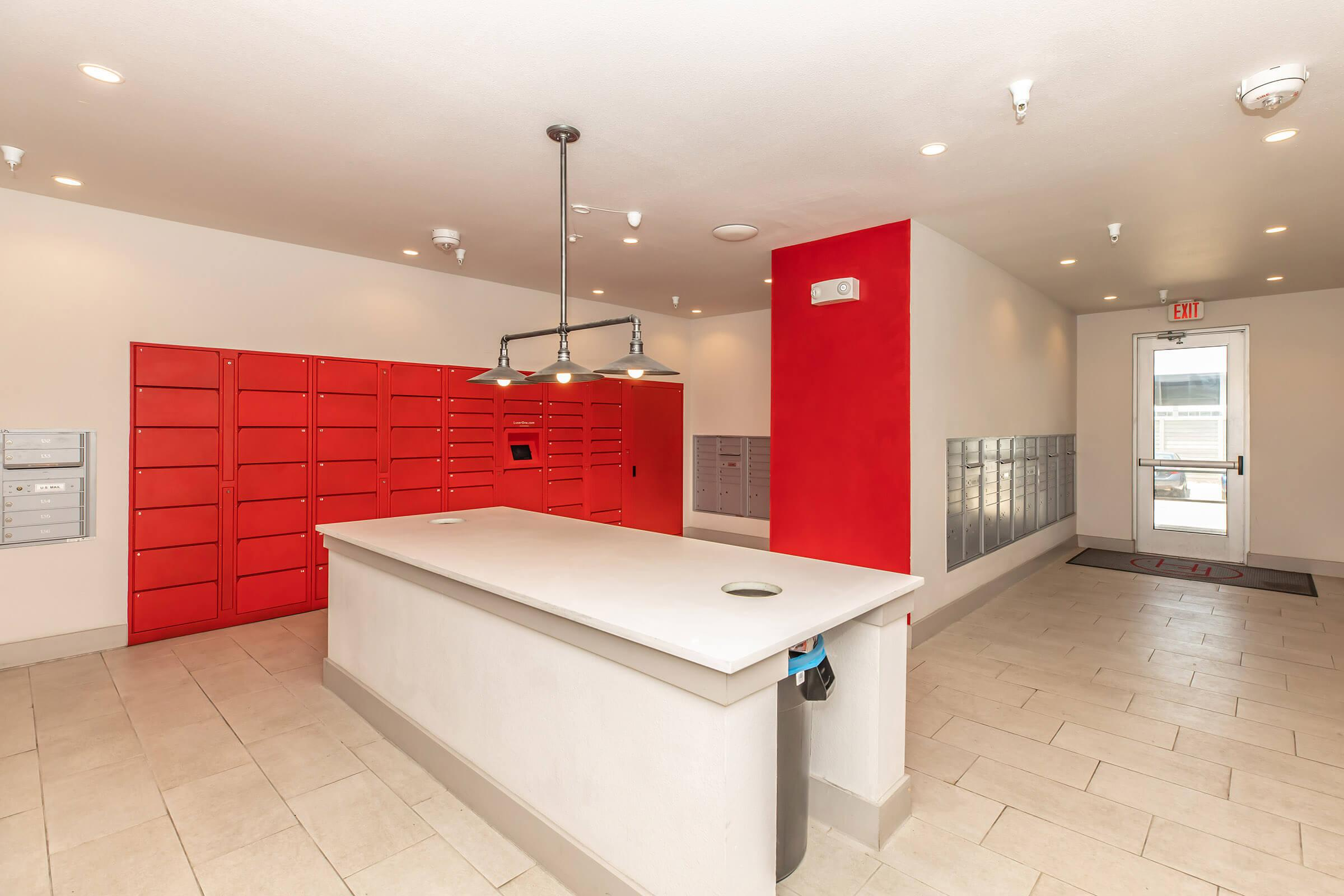 a kitchen with red floor