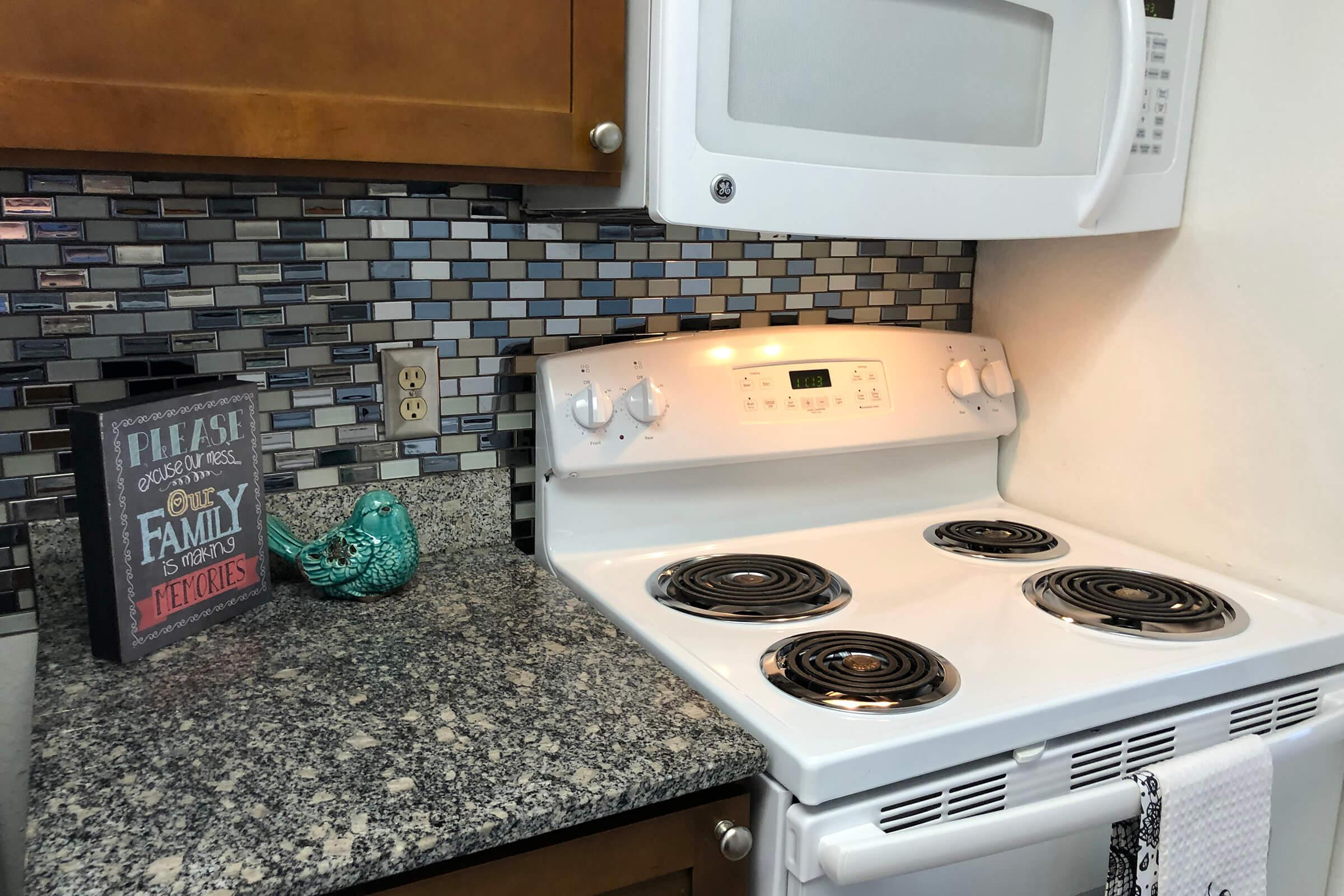 a stove top oven sitting inside of a kitchen