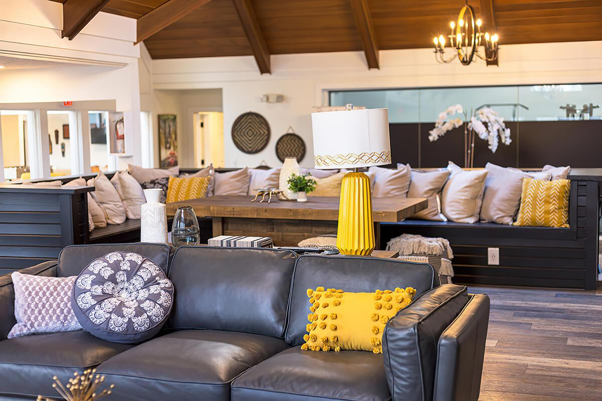 a living room filled with furniture and a fireplace