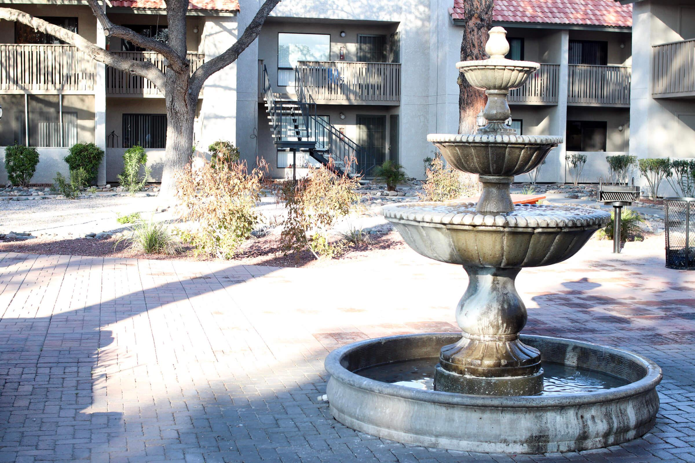 a fountain in front of a building