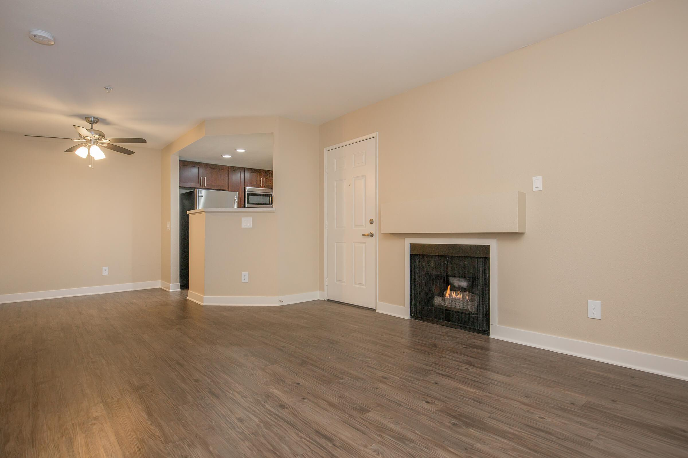 Vacant living room with fireplace
