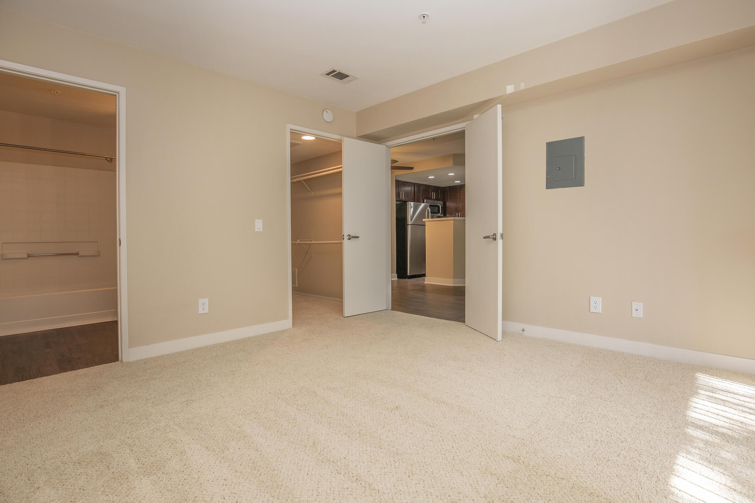 Vacant master bedroom with closet and bathroom