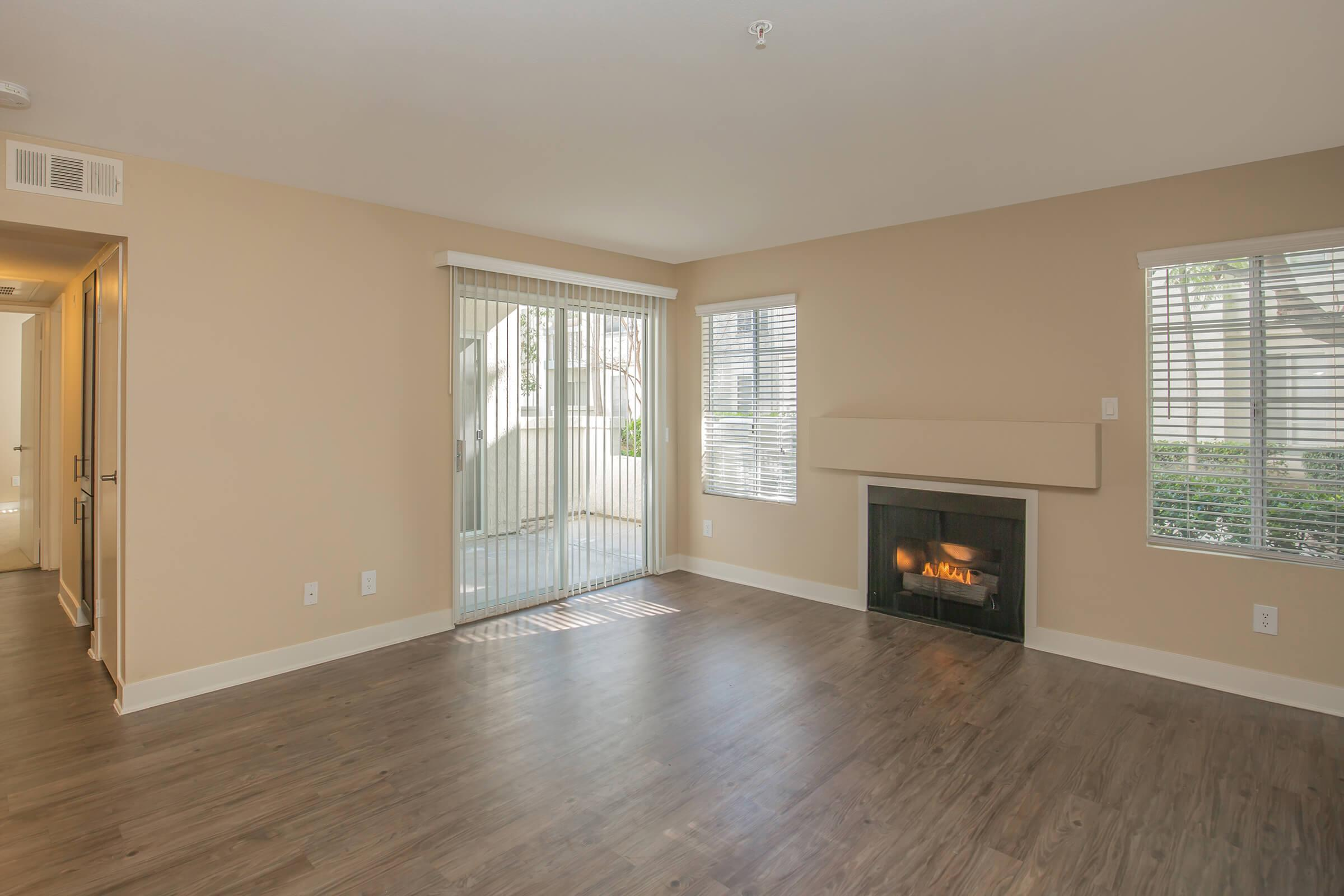 Unfurnished living room with a fireplace