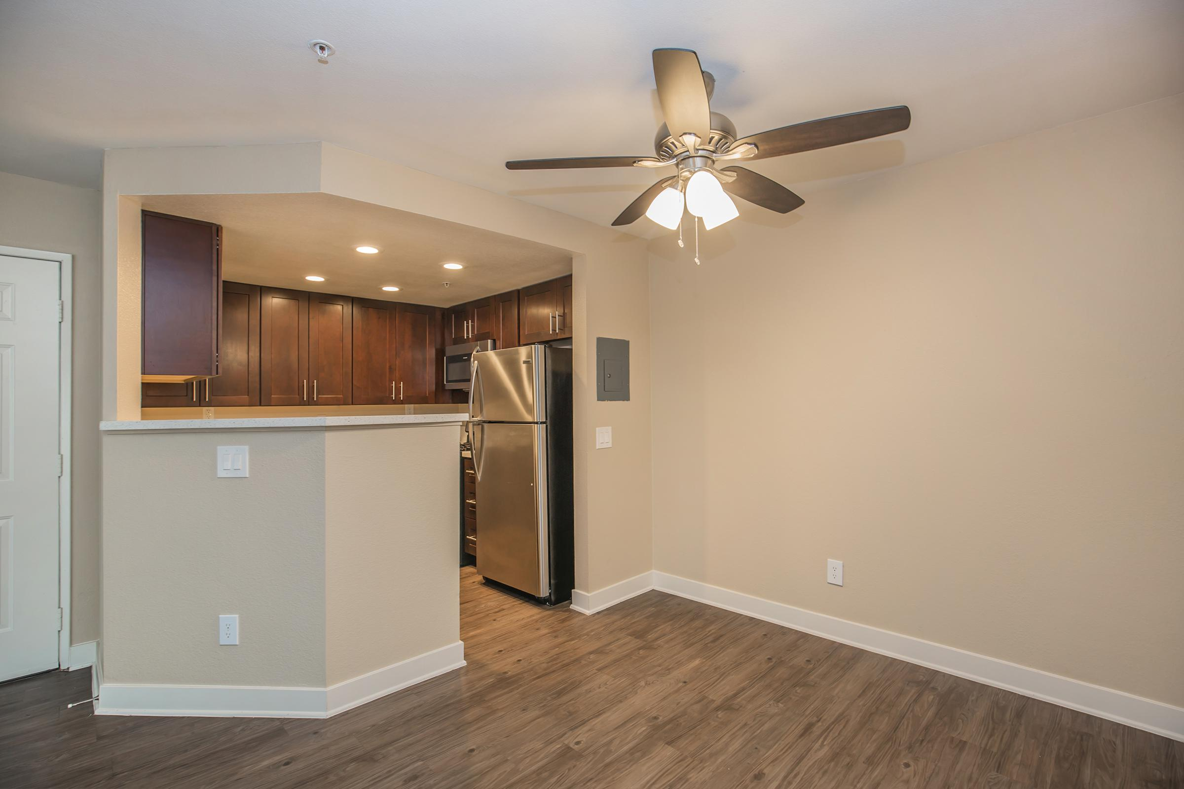Unfurnished dining room with kitchen