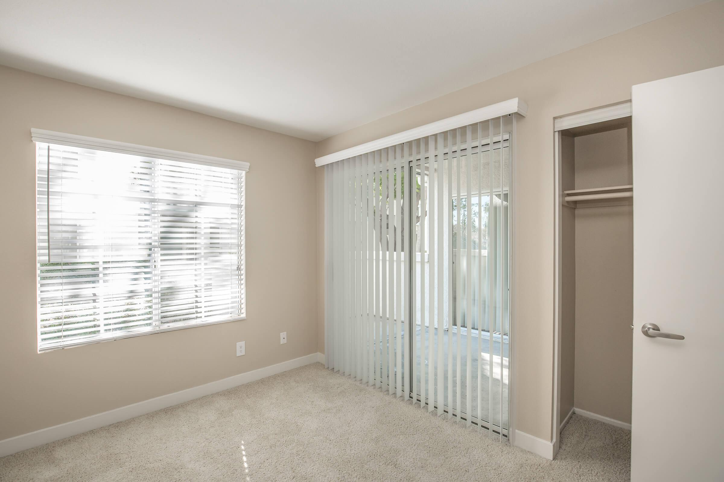 Unfurnished bedroom with glass sliding doors to patio