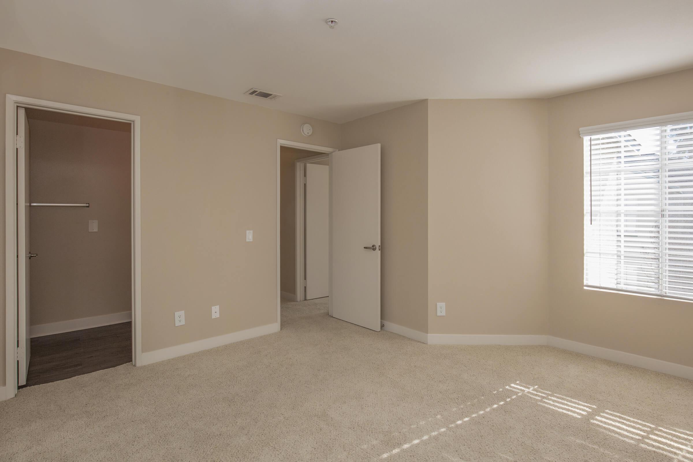 A vacant bedroom with open closet