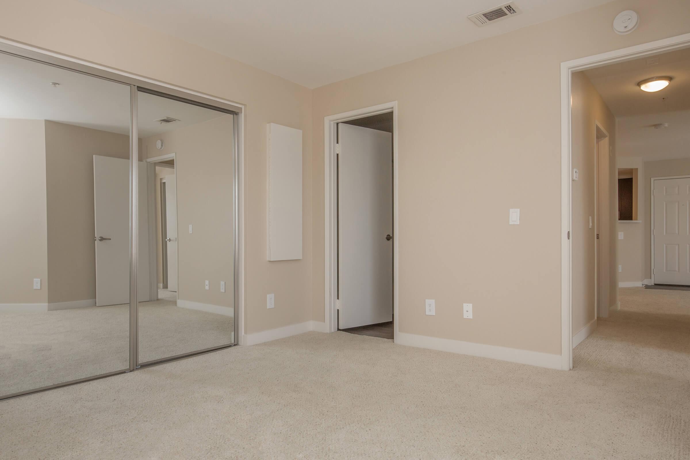 Second bedroom with sliding glass closet doors