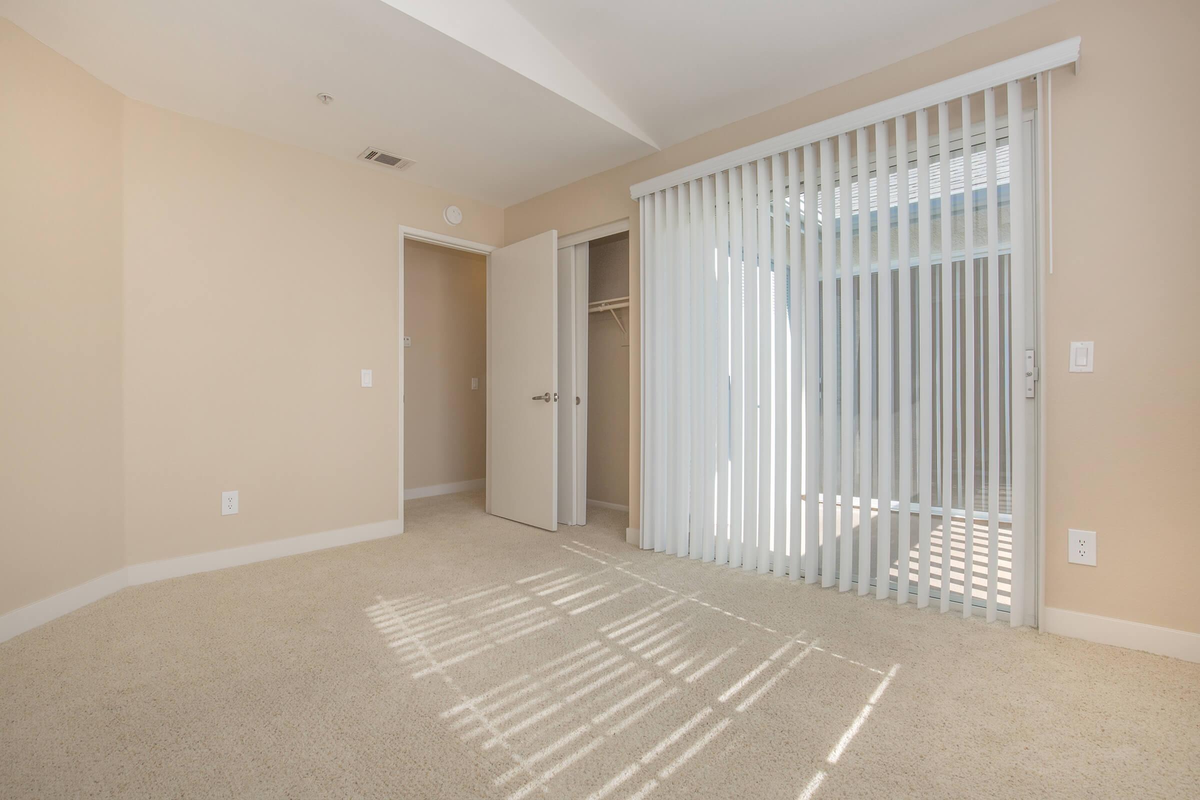 Second bedroom with glass sliding doors to patio