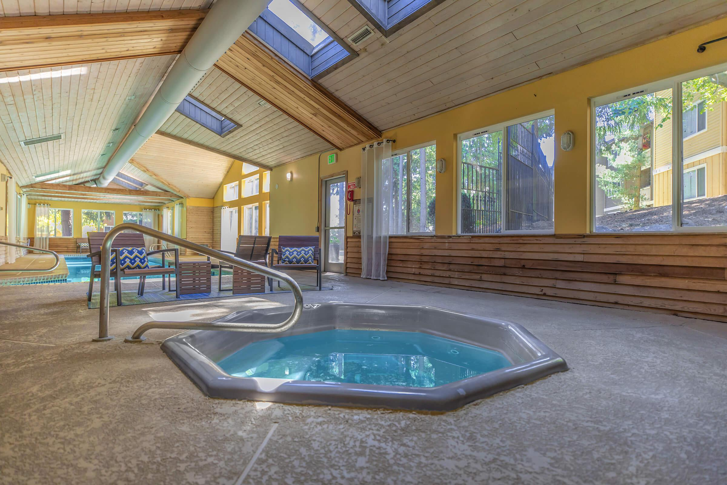 a room with a pool in front of a window