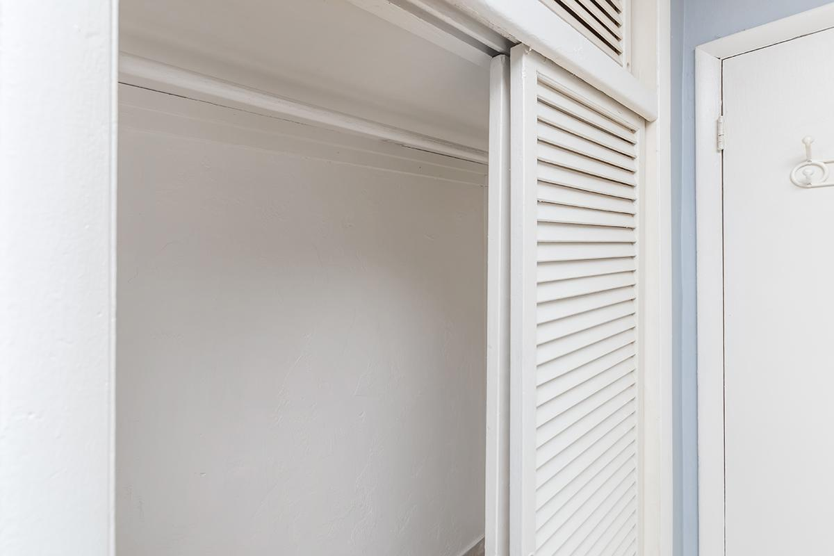 a white door next to a window