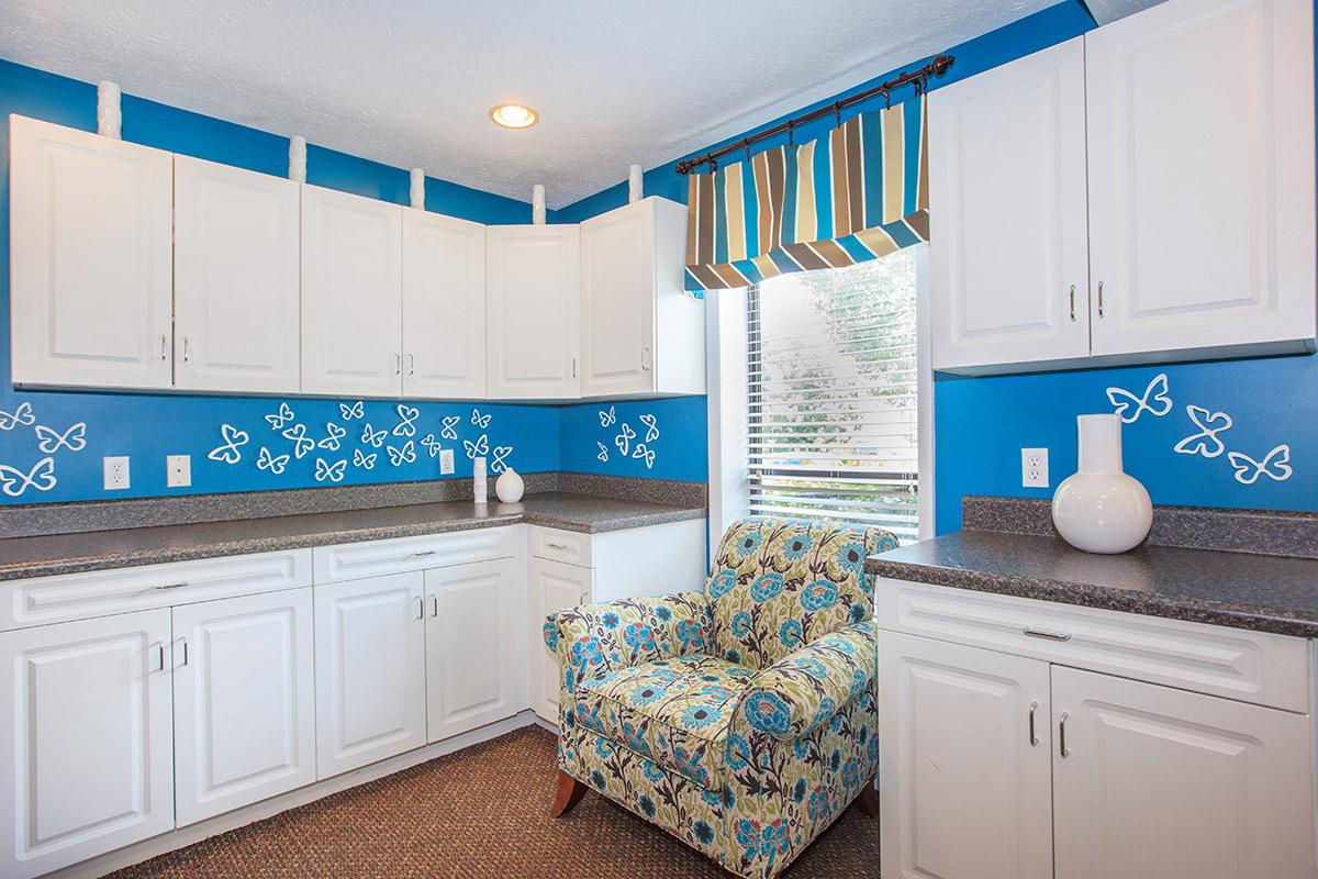 a kitchen with a blue background
