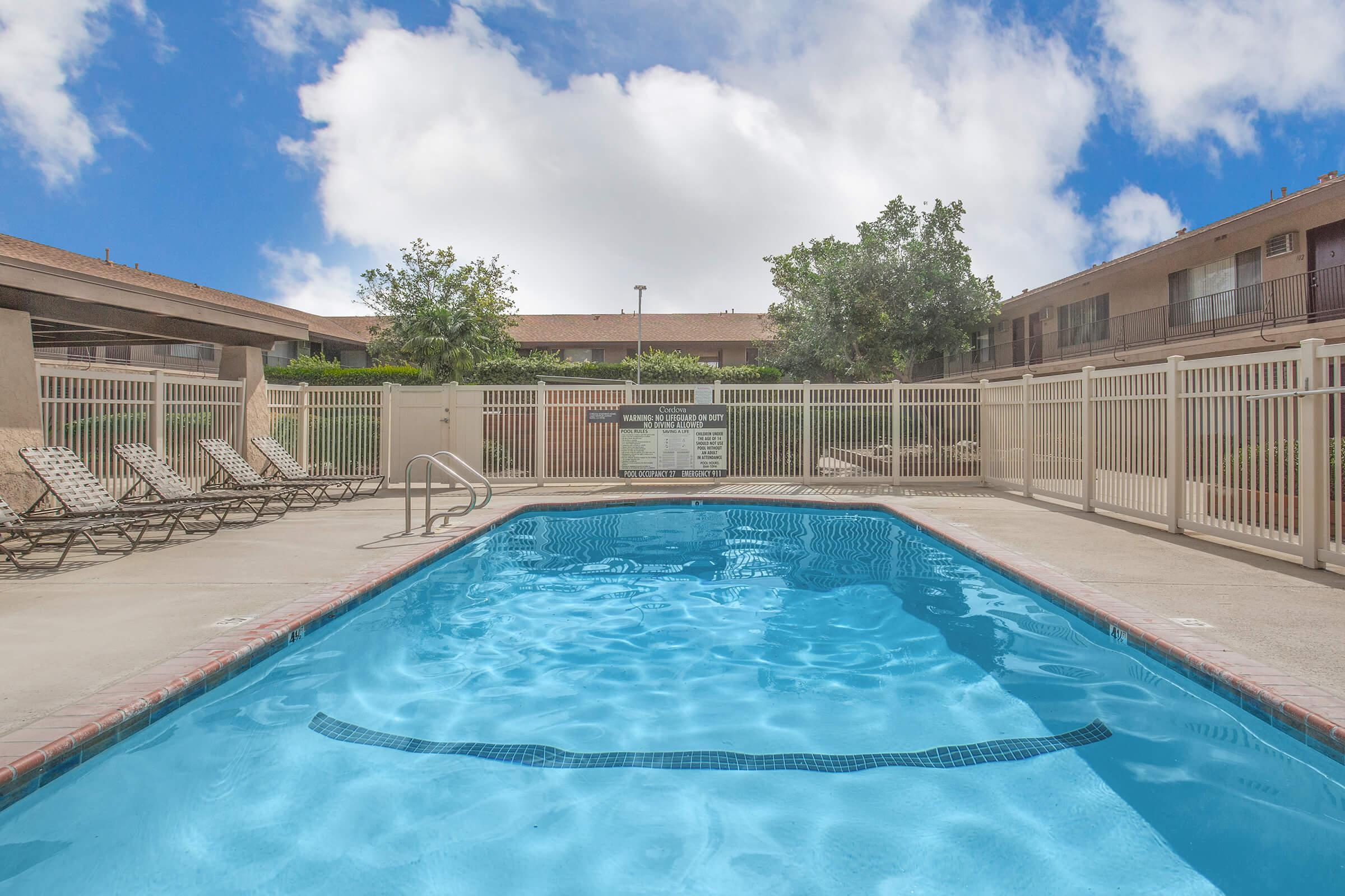 Castilian and Cordova Apartment Homes community pool with chairs