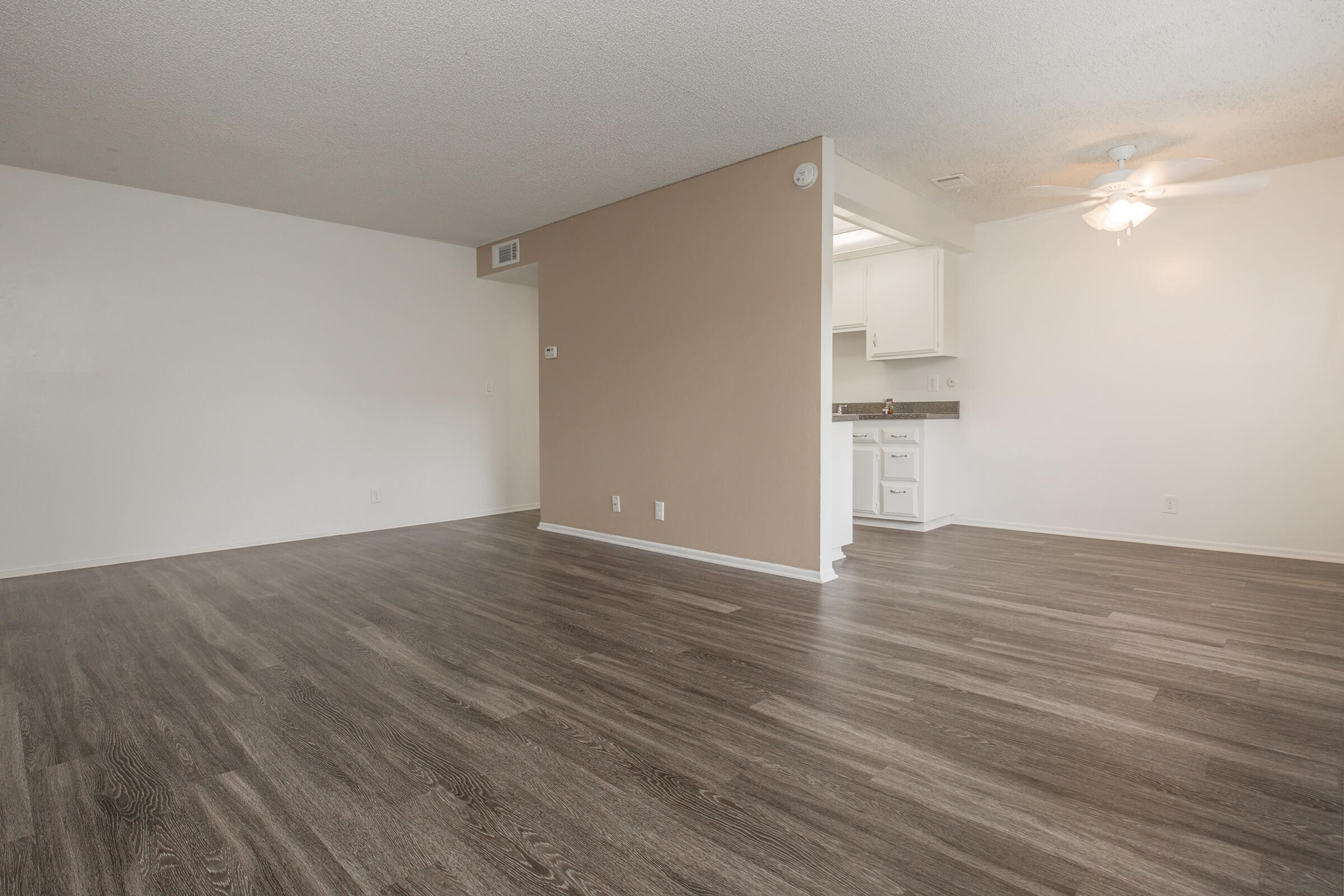 Unfurnished living room and kitchen