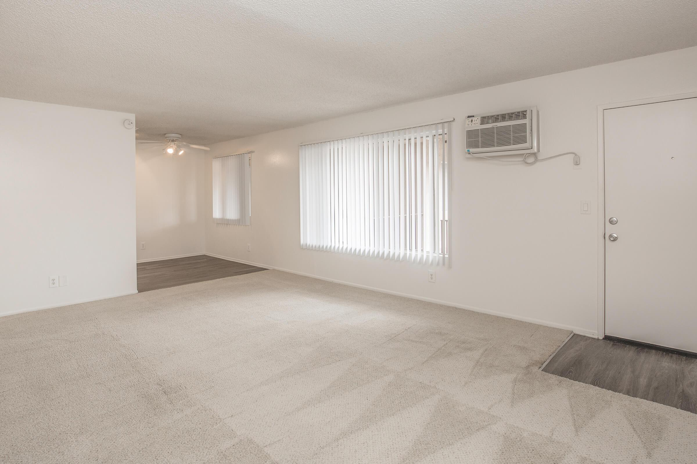 Unfurnished living room with front door