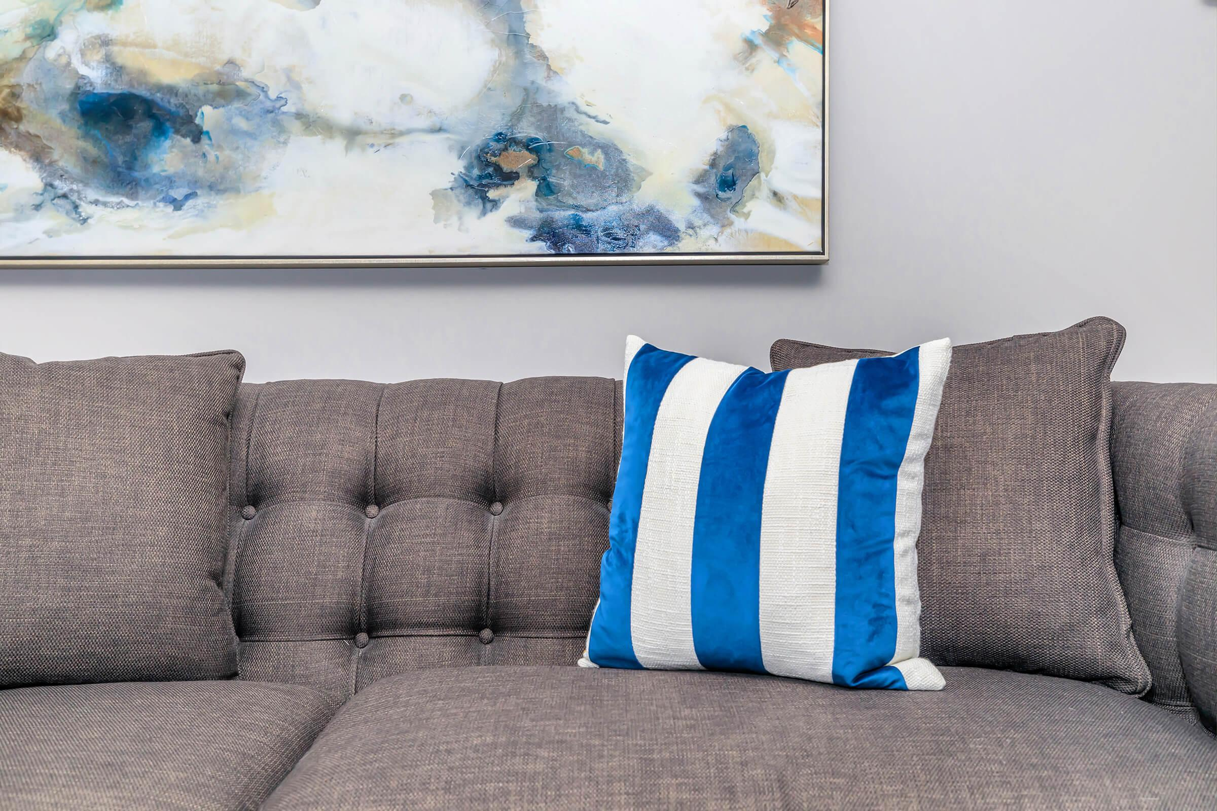 a living room with a blue seat