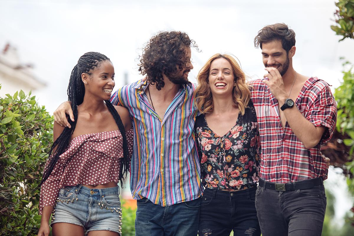 a group of people standing next to a person