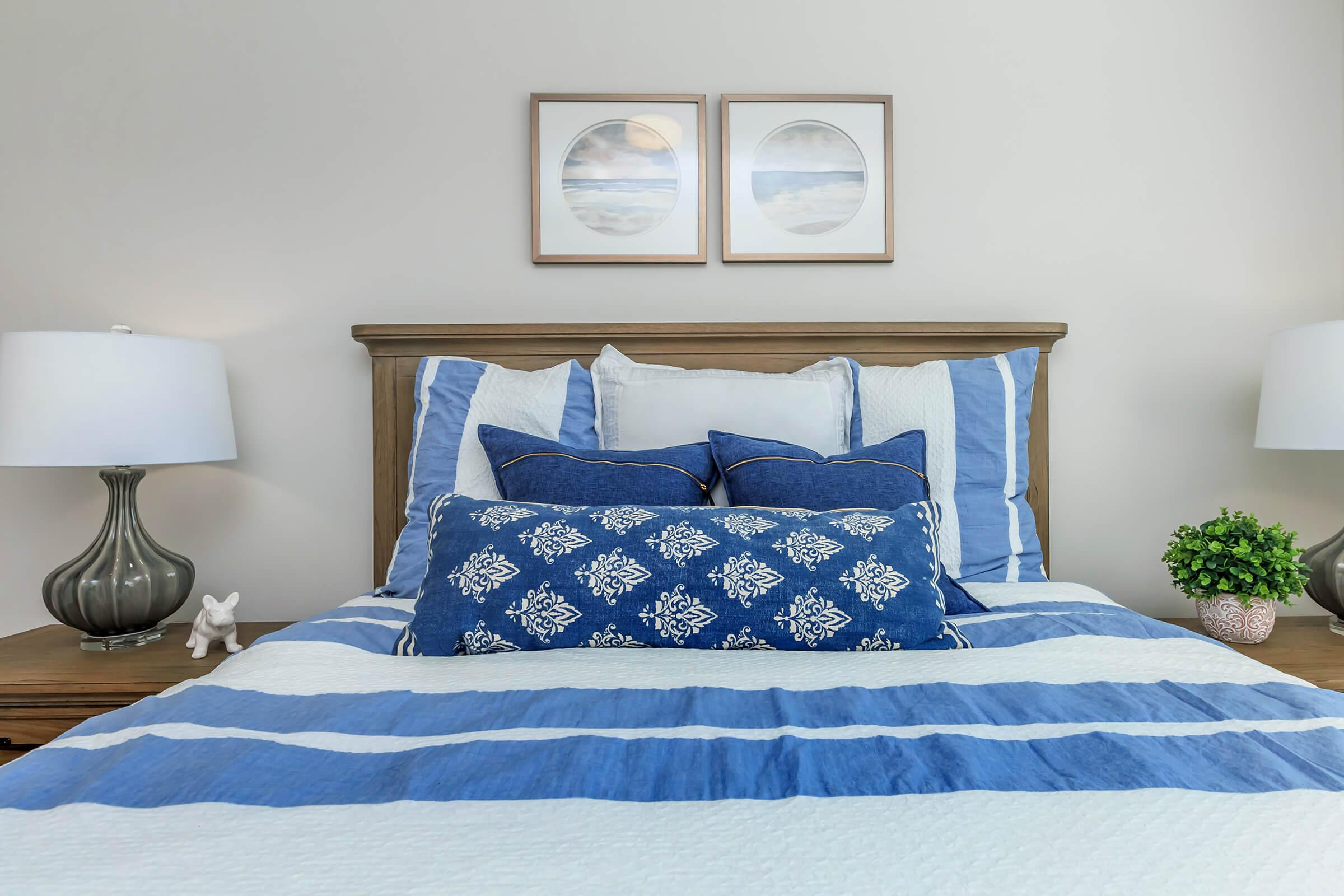 a bedroom with a bed and a blue blanket