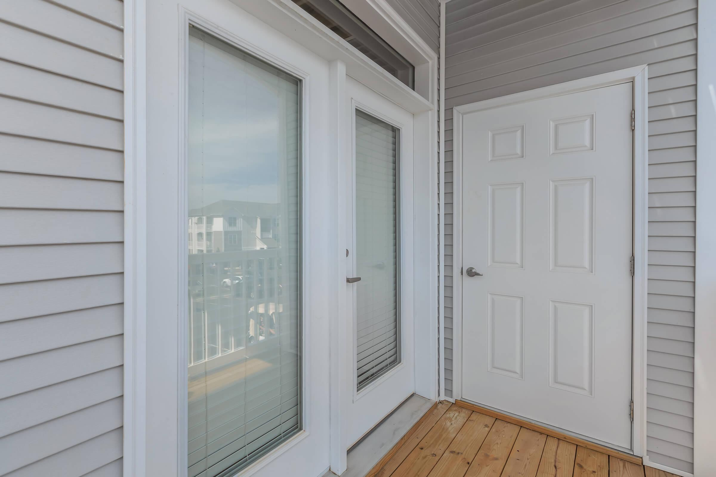 a white door next to a window