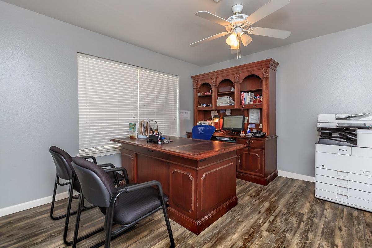 a room filled with furniture on top of a wooden desk