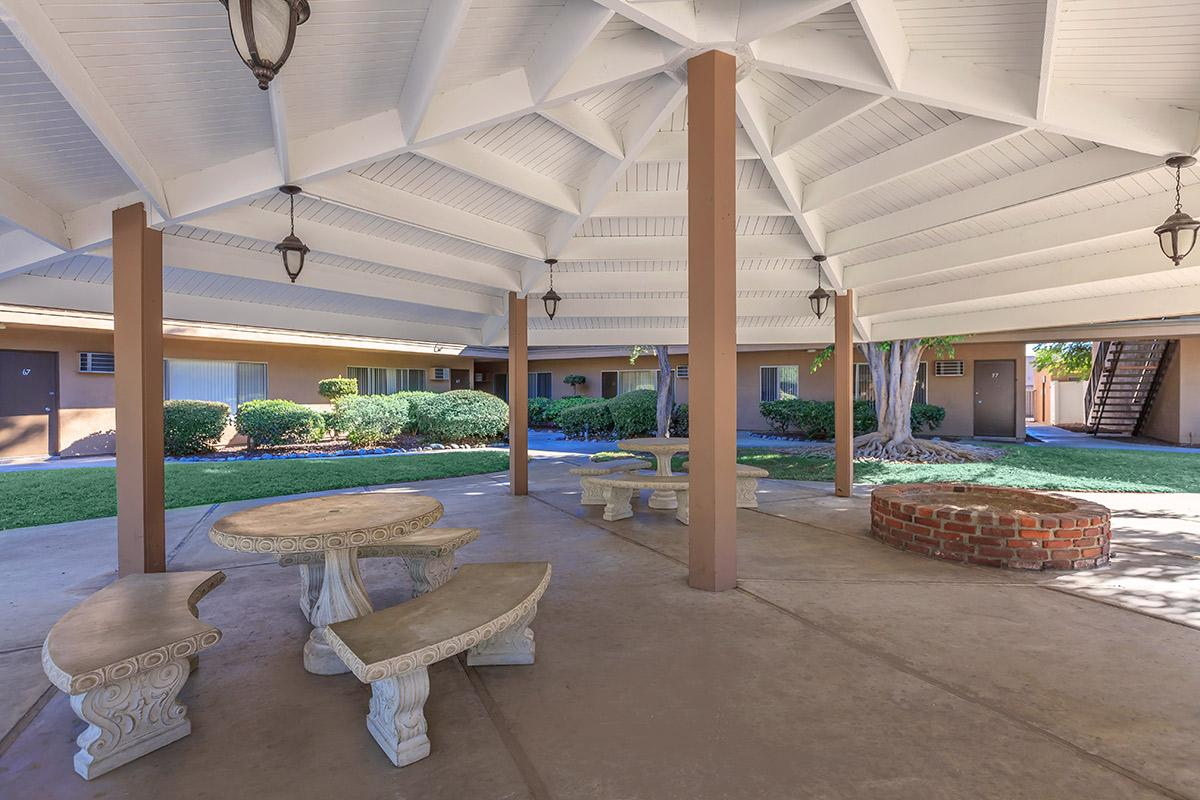 Firepit and picnic tables under gazebo