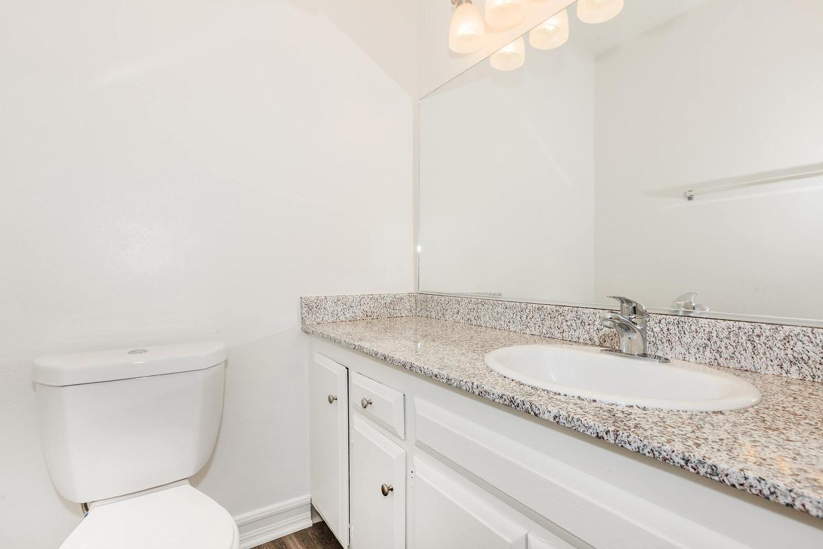 Unfurnished bathroom with white cabinets