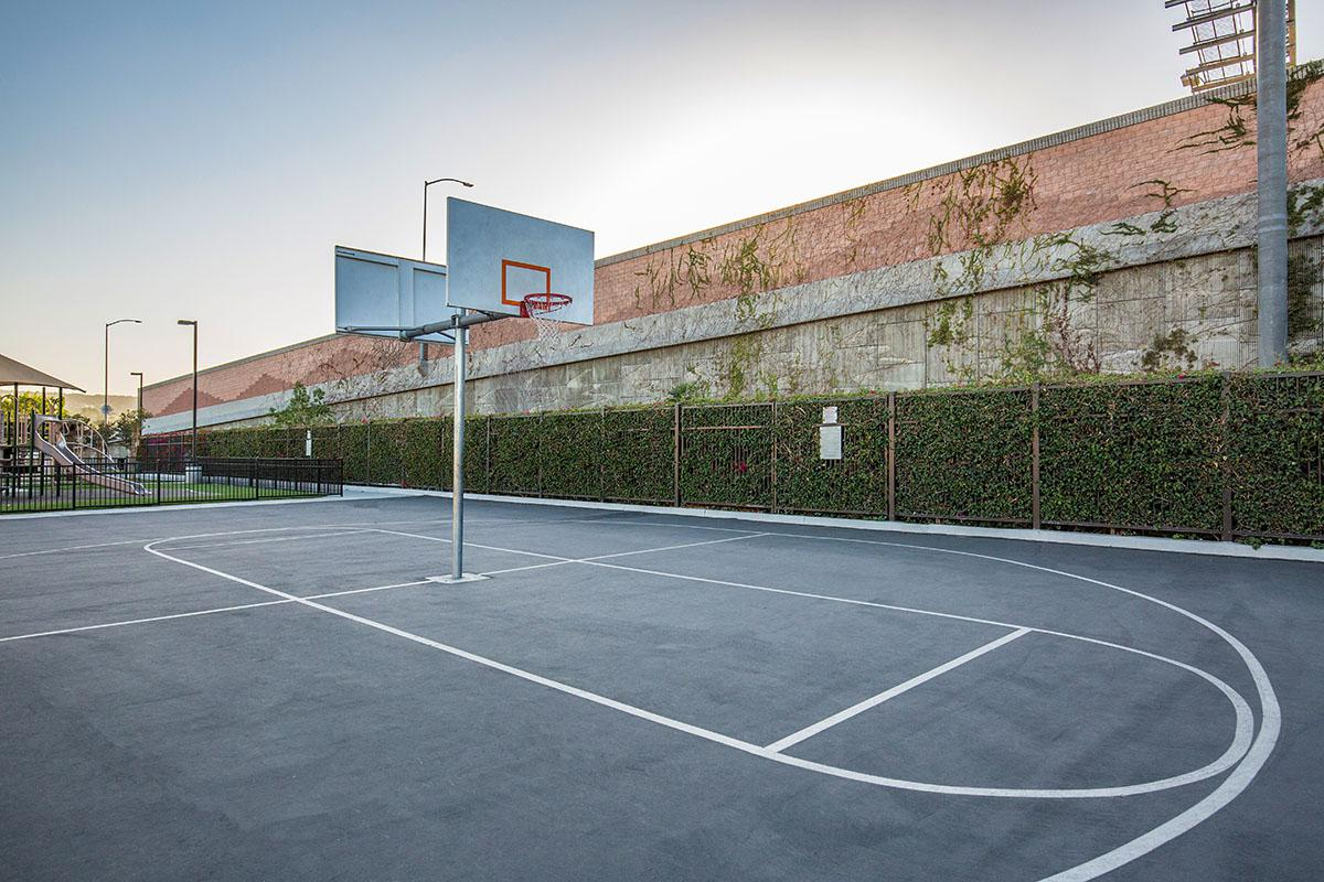 a basketball in a parking lot