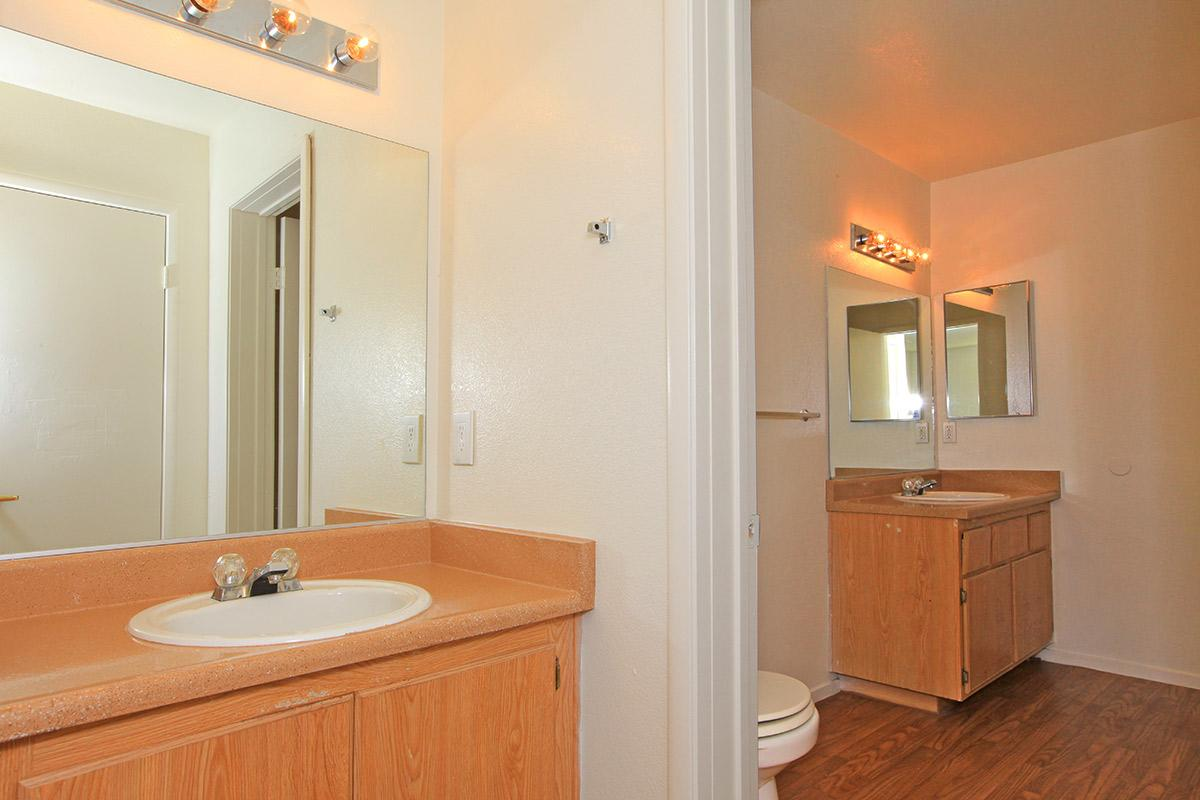 Bathroom with two vanities at Toscana