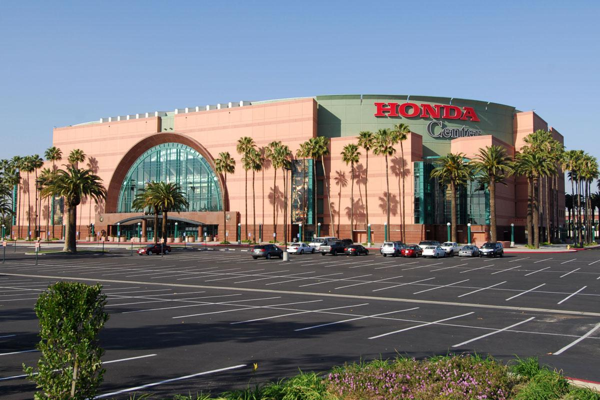 Honda Center that has a sign on the side of a road