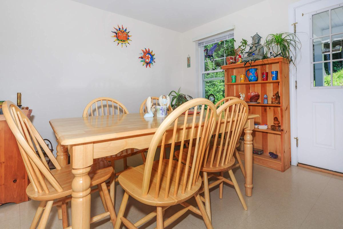 a dining room table in front of a wooden chair