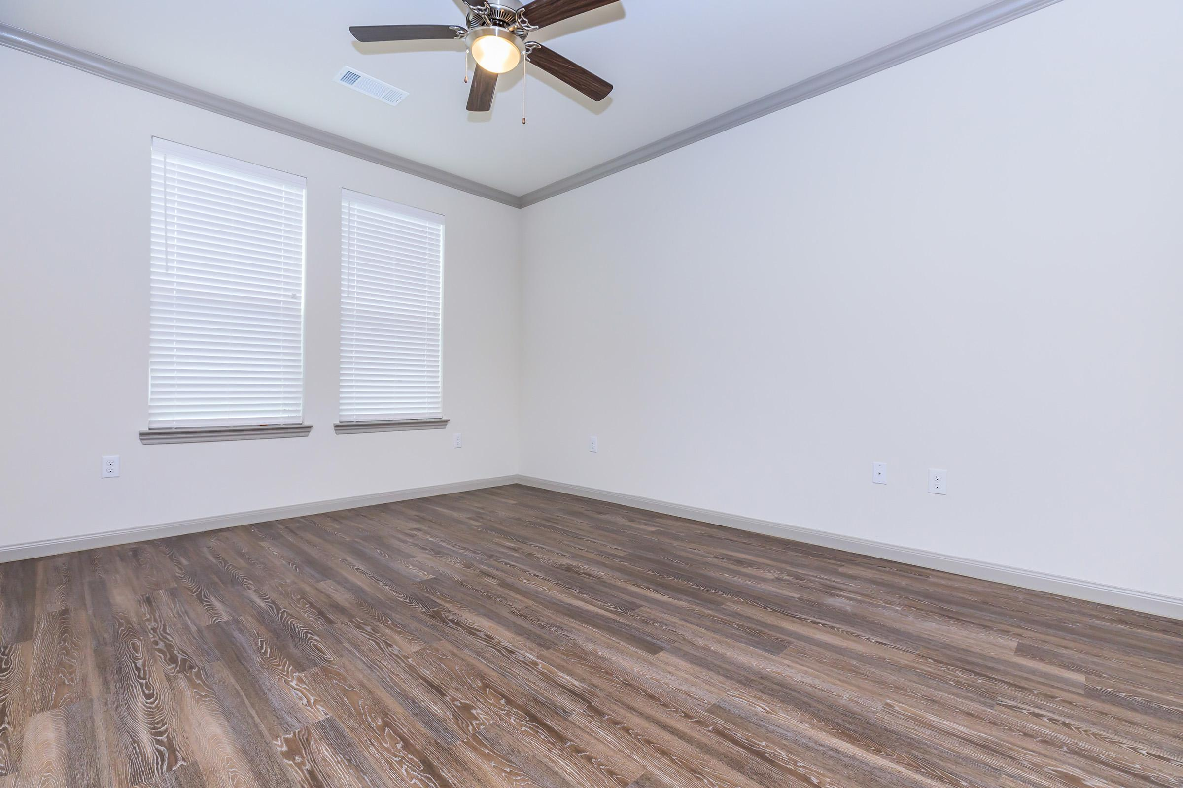 SPACIOUS LIVING ROOM AT THE RETREAT AT BARBERS HILL