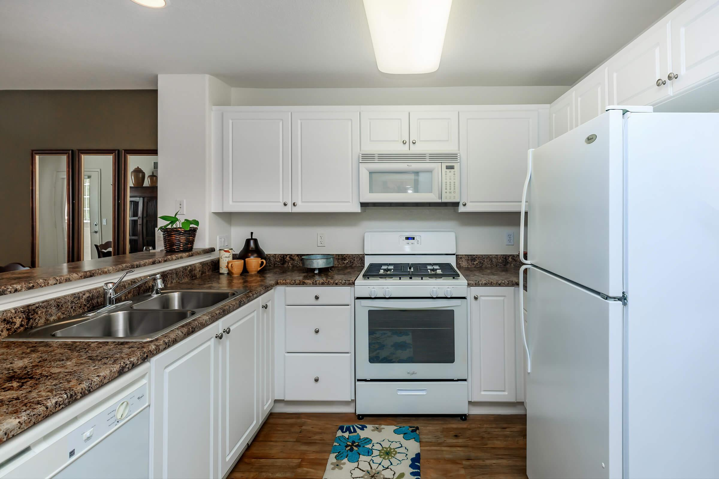 a kitchen with a white stove top oven