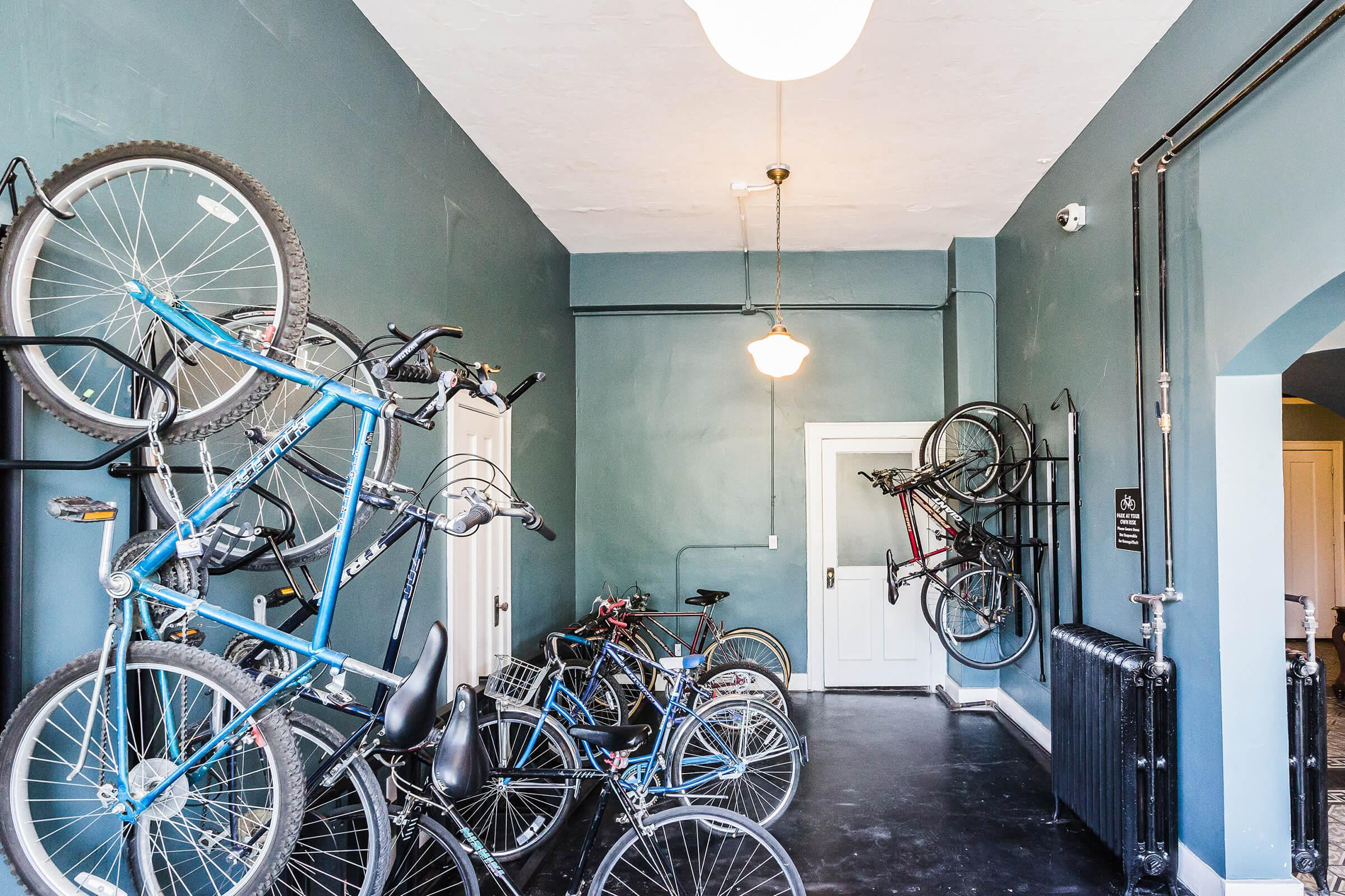 a bicycle parked on the side of the room
