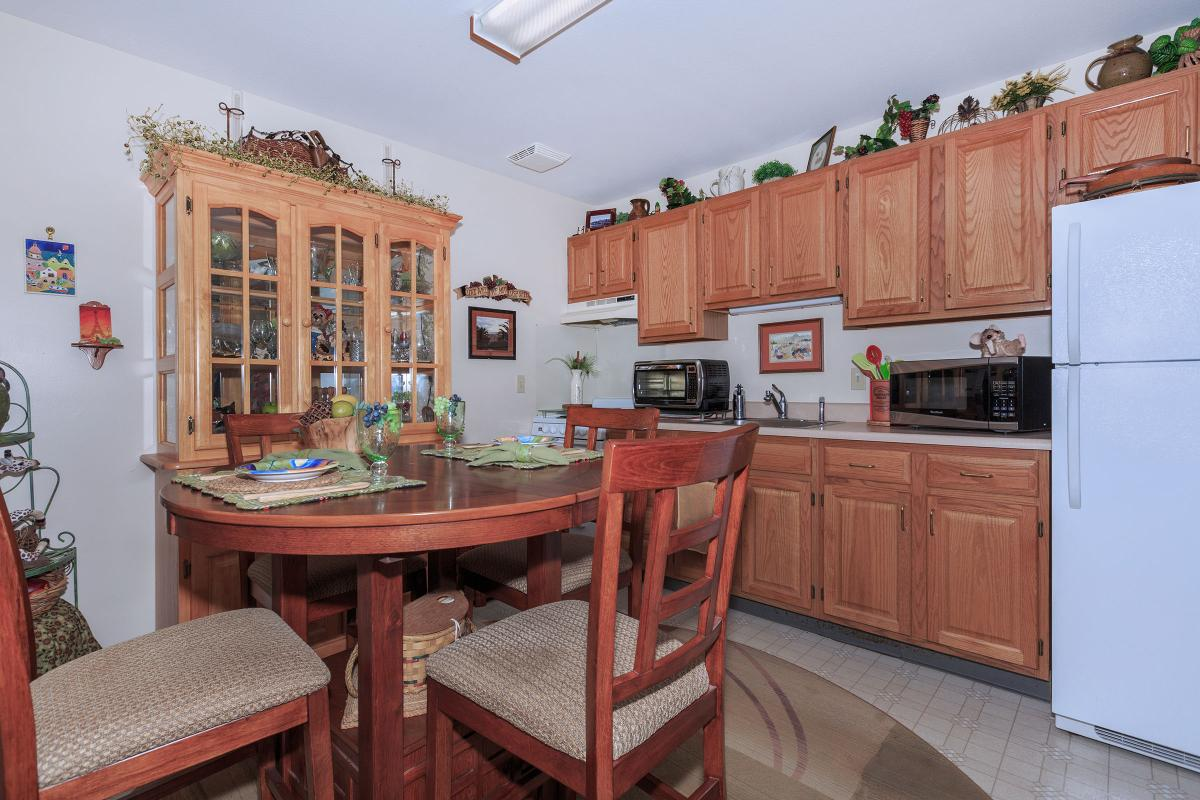 a kitchen with a red chair