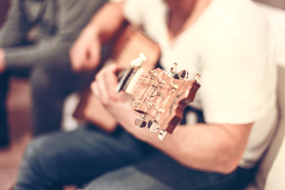 a man holding a guitar