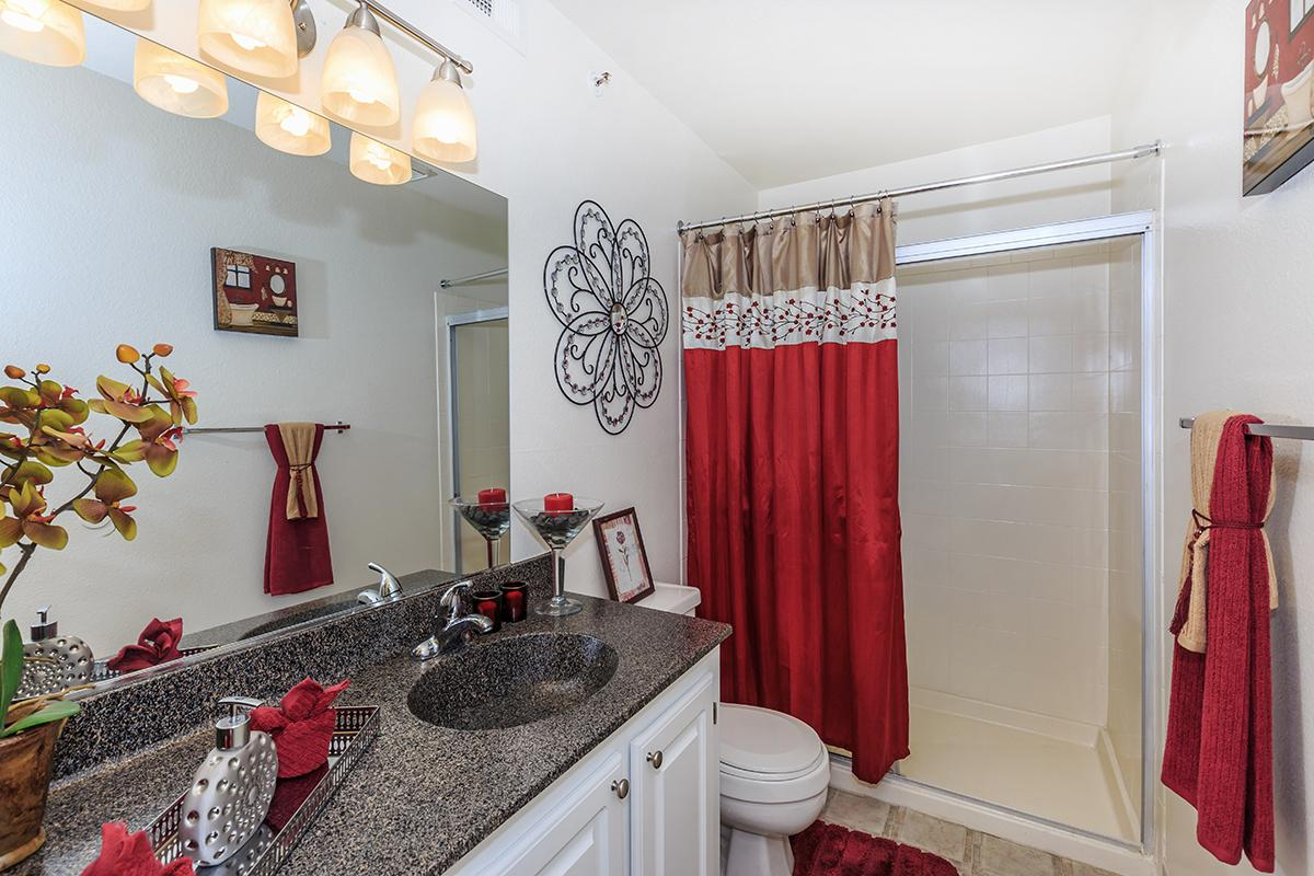 a bedroom with a red shower curtain