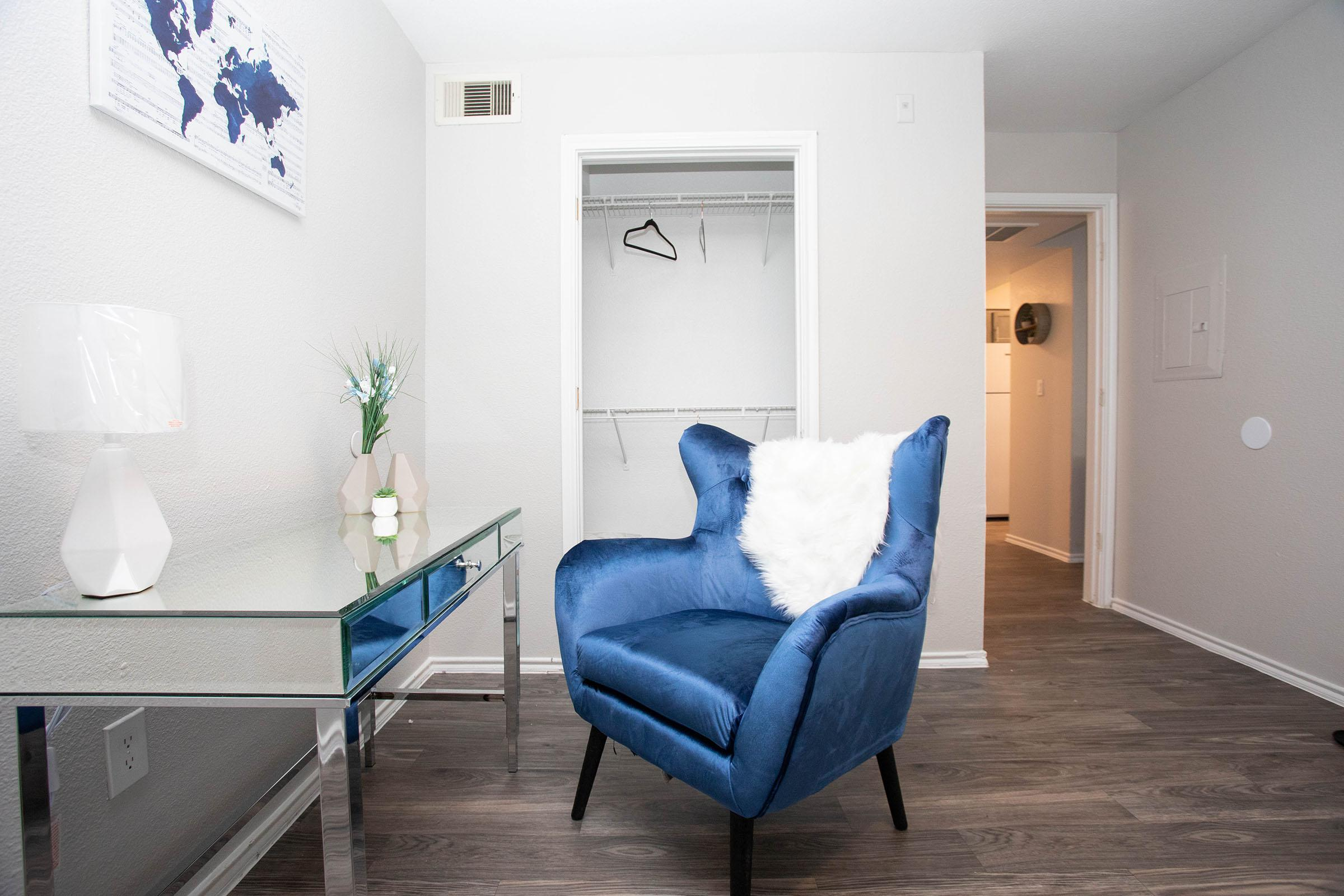 a bedroom with a blue background