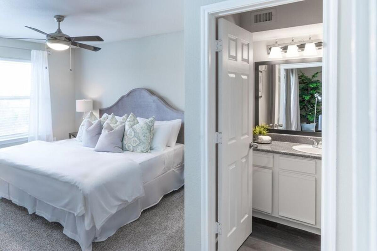 a large white bed in a room