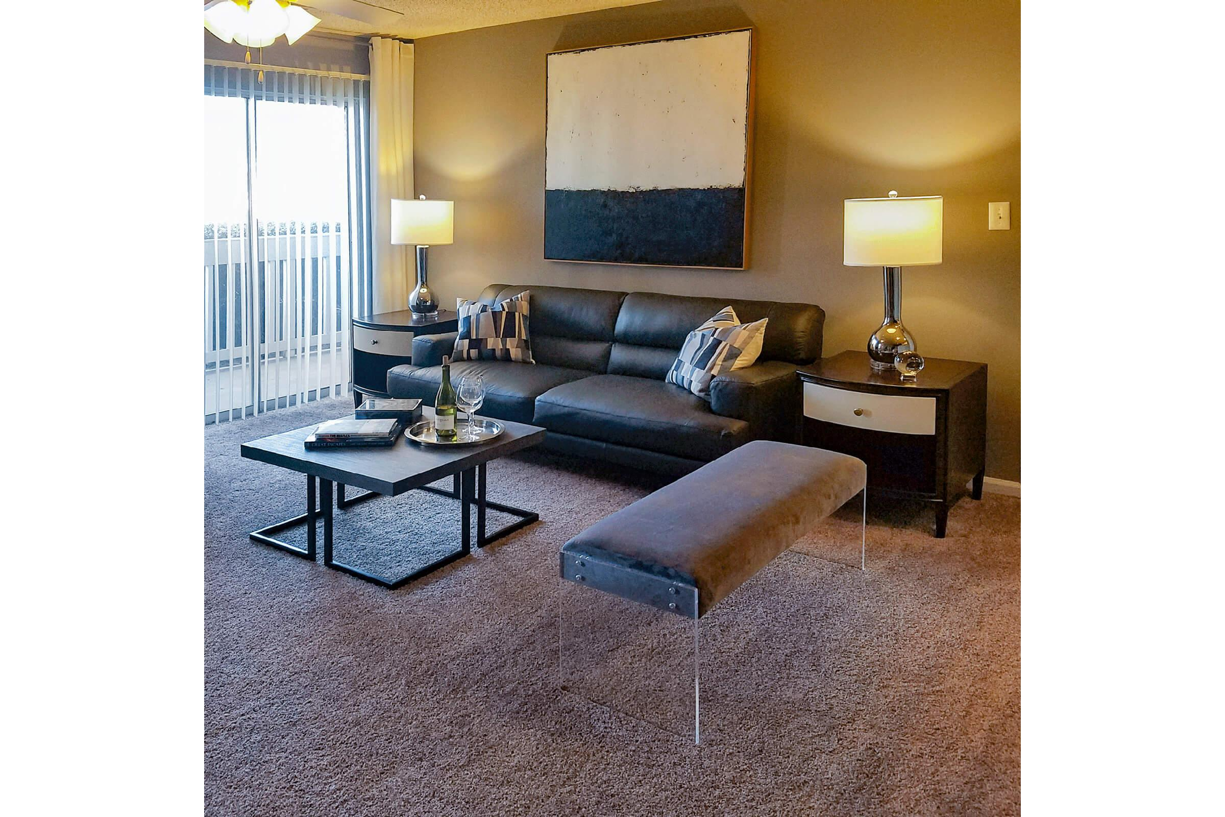 a living room filled with furniture and a lamp