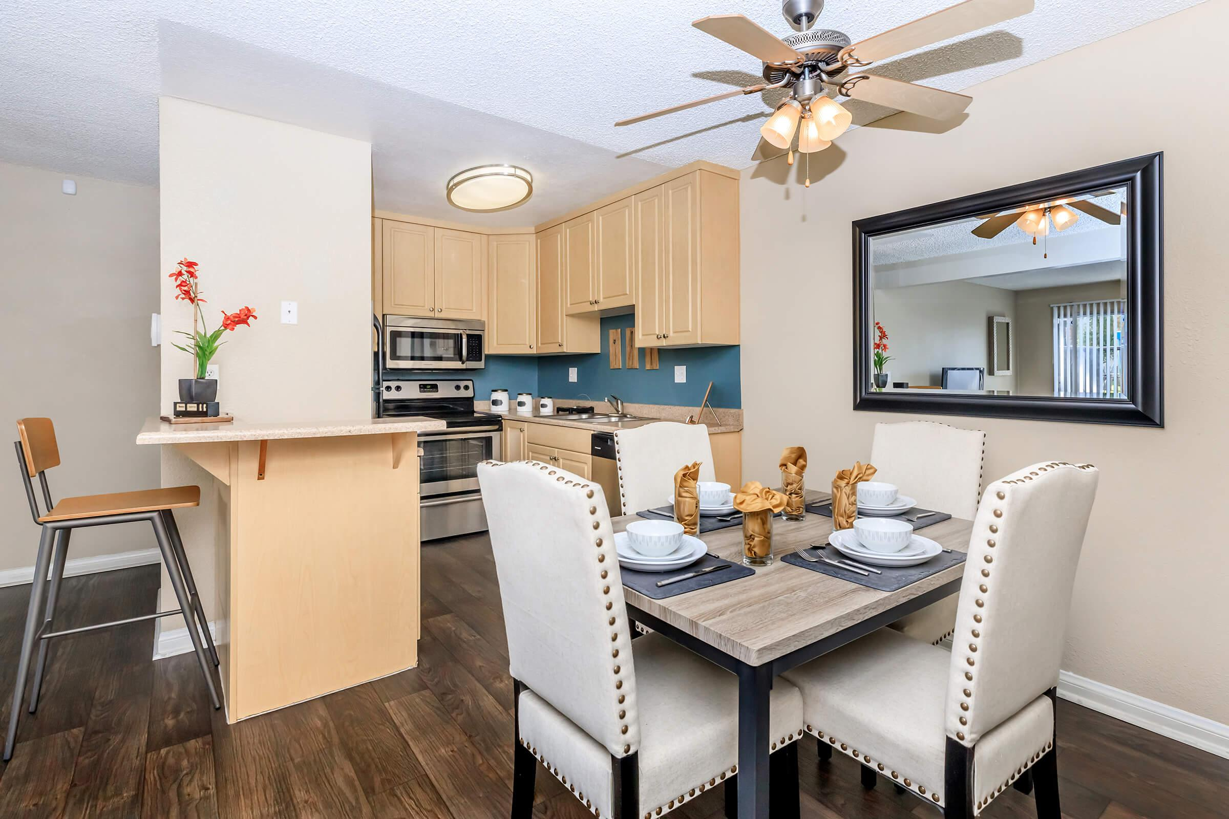 a kitchen with an island in the middle of a room