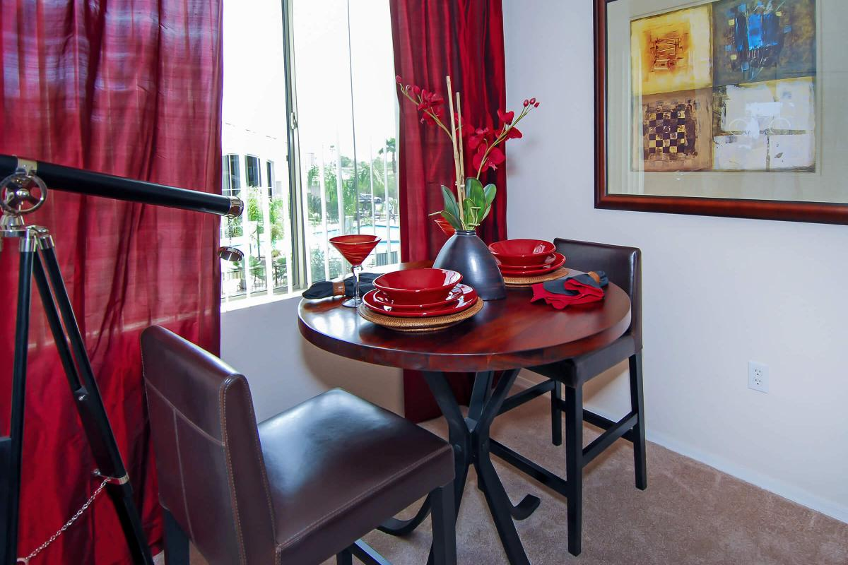 a large red chair in front of a curtain