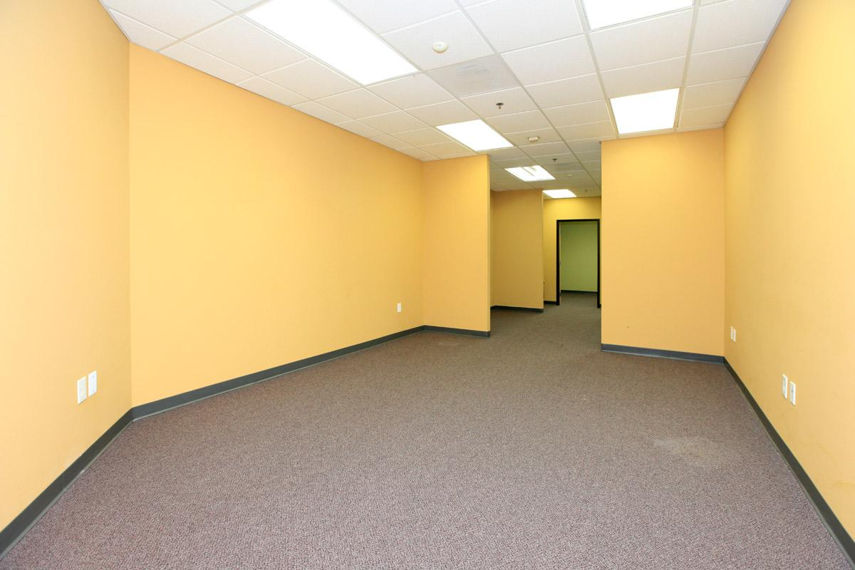 a large empty room with yellow walls