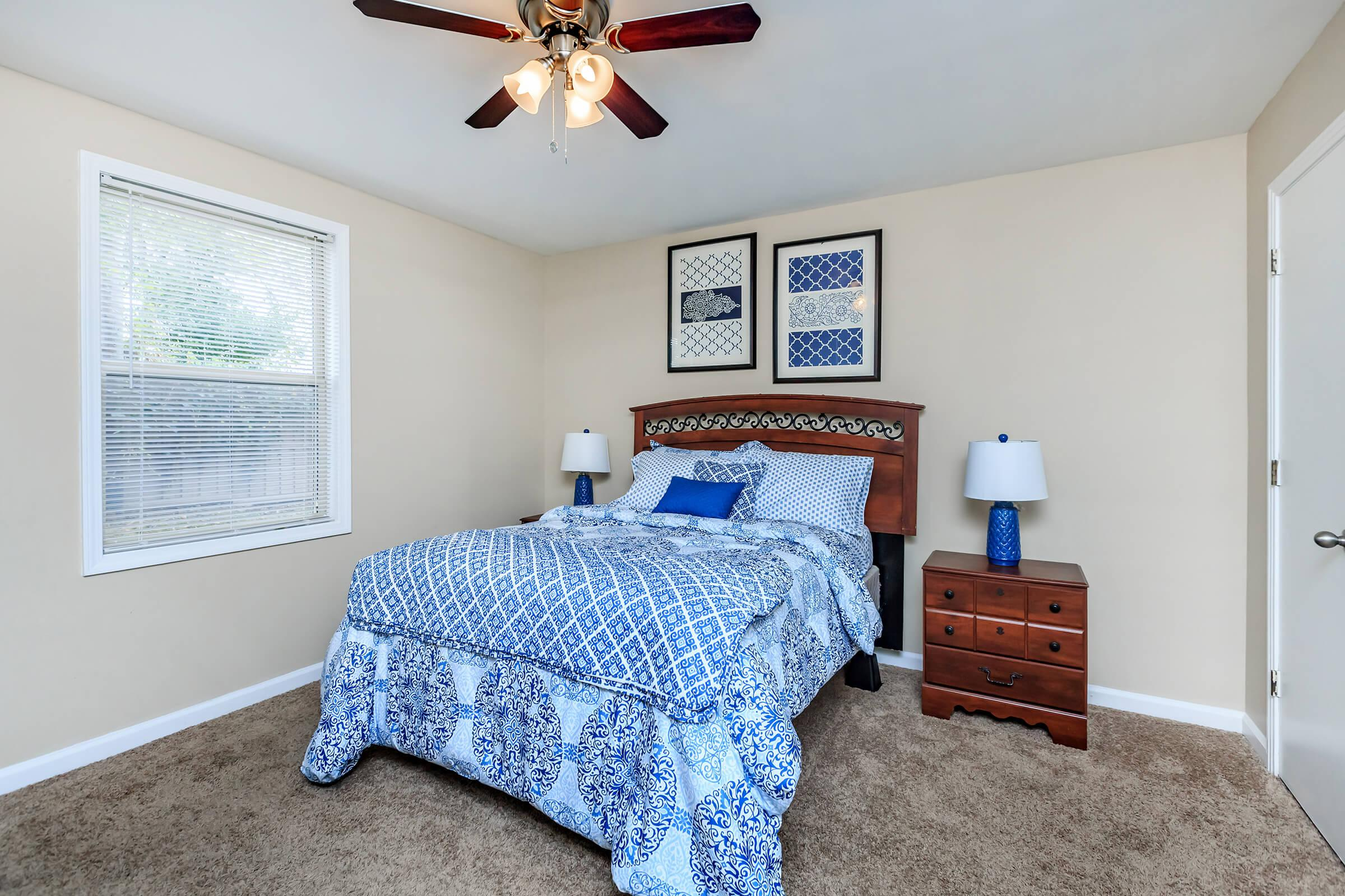 a bedroom with a blue blanket