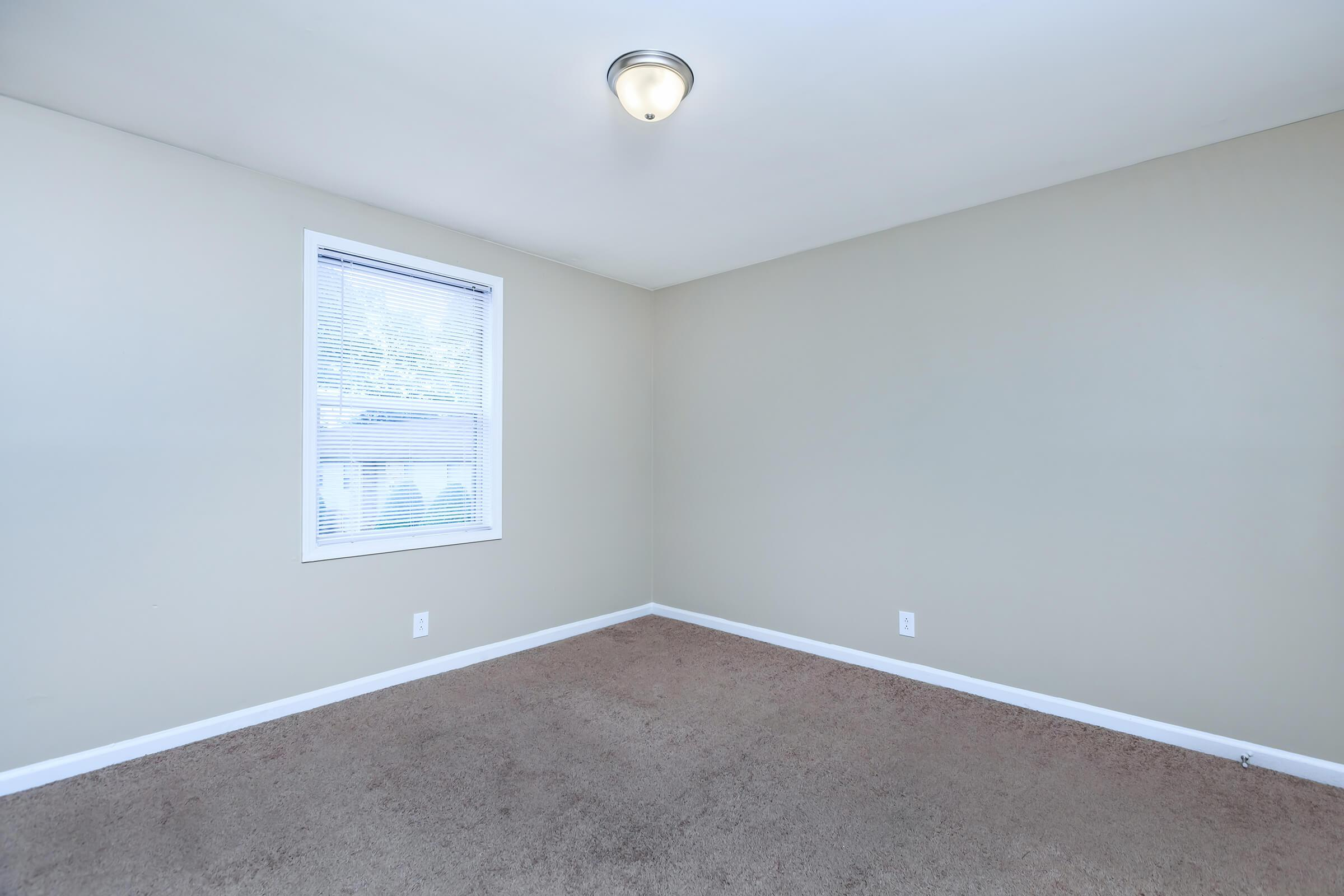 Plush carpeting in bedrooms at The Residences at 1671 Campbell in Clarksville, Tennessee