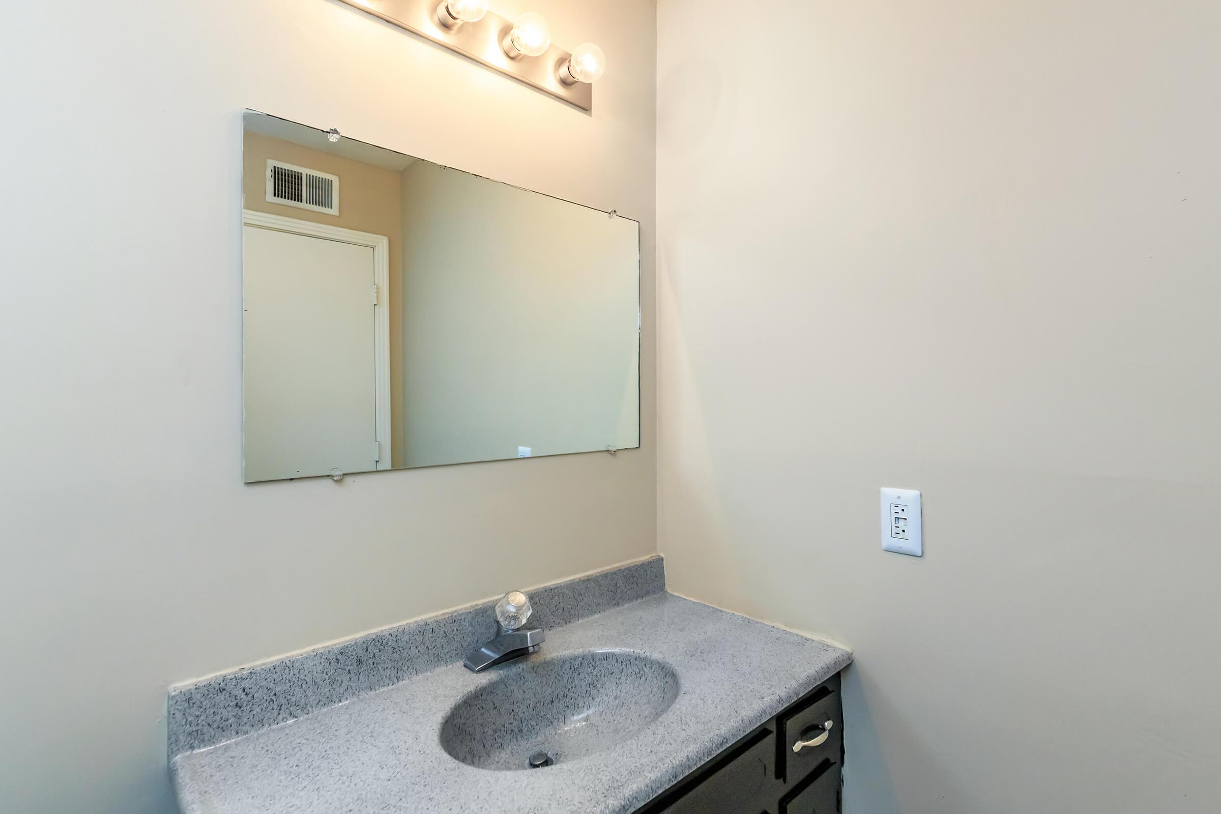 Modern bathrooms at The Residences at 1671 Campbell in Clarksville, TN