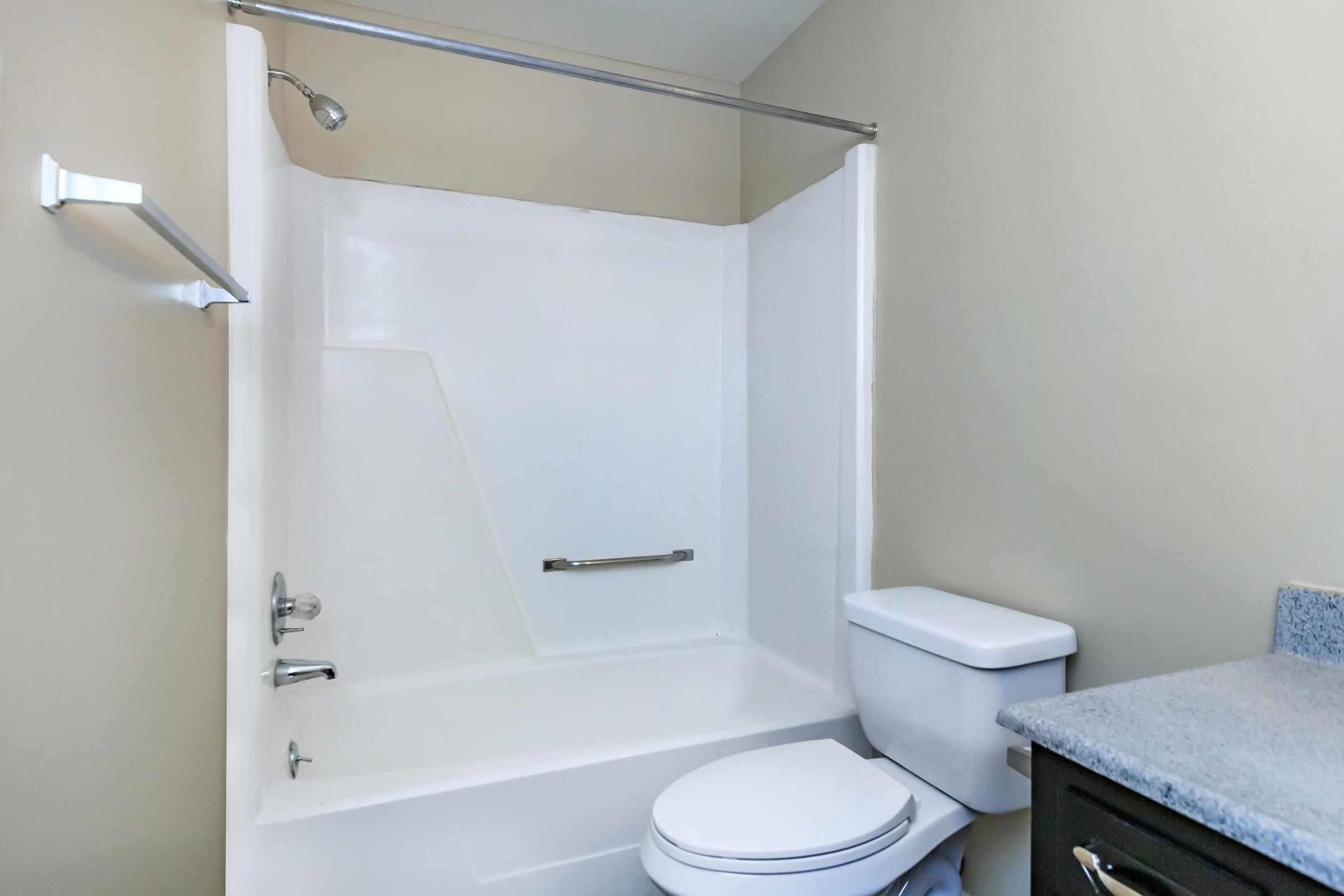 a room with a sink and a bath tub