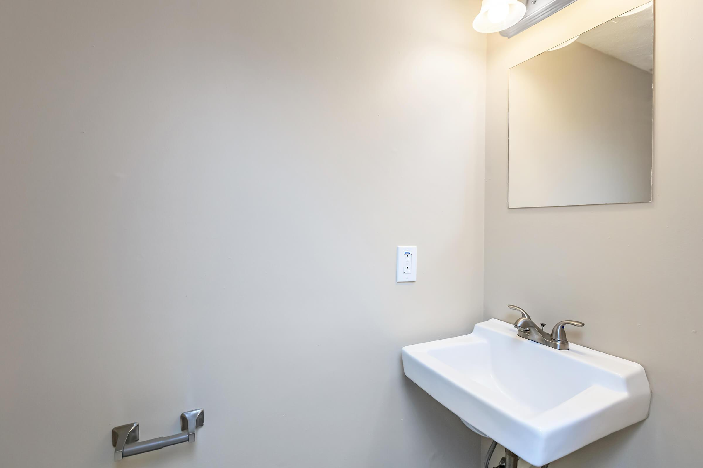 Chic bathrooms at The Residences at 1671 Campbell in Clarksville, TN