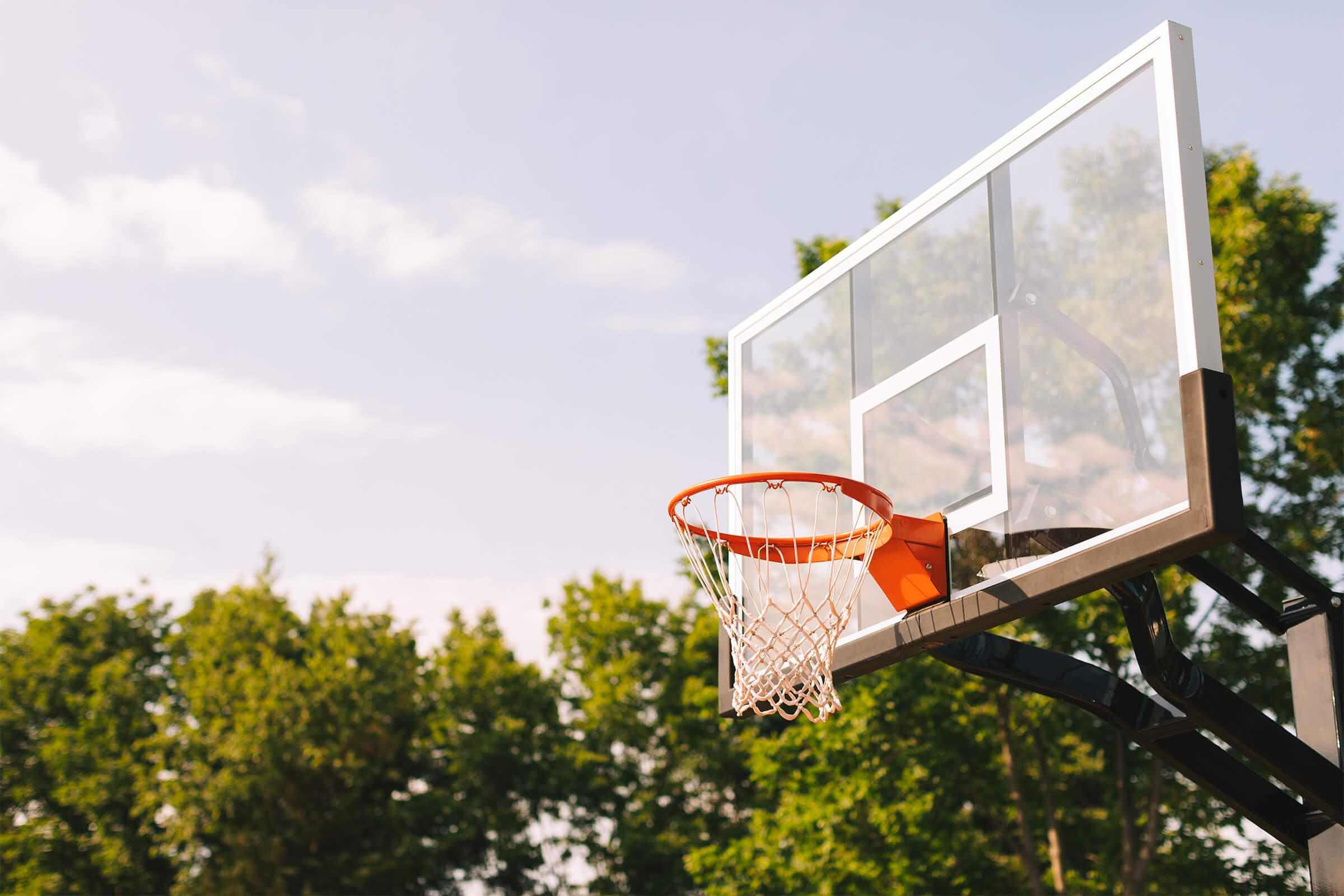a person flying through the air on a basketball court