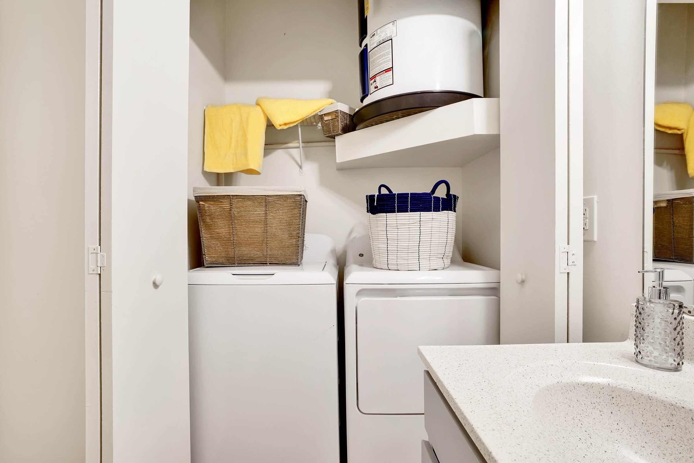 a white refrigerator freezer sitting next to a sink